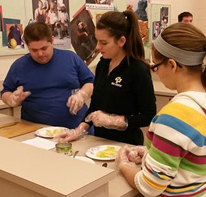 Emily Macalka volunteers with special education students at Comstock Park High School