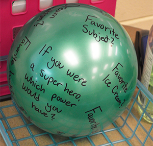 Students used props to answer questions about themselves