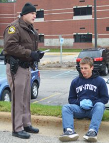 Junior Nick Turowski talks with a police officer following the crash