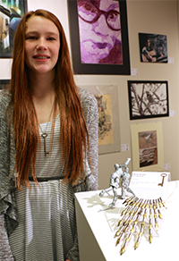 """Byron Center West Middle School student shows her piece, """"Neck Nib"""""""