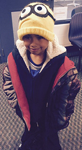 A Godfrey Lee Early Education Center student is all bundled up in a hat from the winter clothes donation