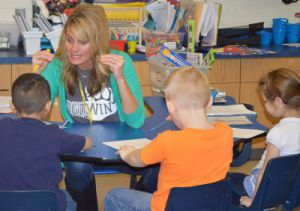 North Godwin Elementary kindergarten teacher Holly Vostad reads with students