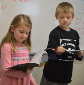Students read different parts in the play