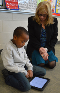 A teacher works on reading with a student