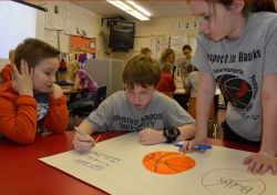 Working together on an anti-bullying poster are (from left) A.J. Gates Joshua Vick and Emma Cassiday