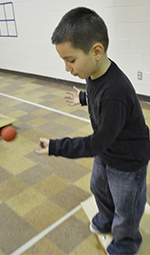 First grader Carlos Salcedo counts, bounces and balances at the same time