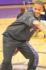 Eighth-grader Brandon Ratliff dances in class