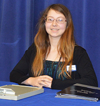 Valleywood Middle School eighth-grader Kristin Crumley takes her position as bank manager
