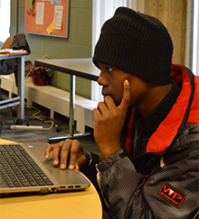 Tevin Applewhite studies at the MySchool@Kent classroom at Kent Career Tech Center