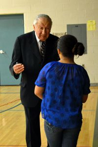 Martin Lowenberg answers a question from a Comstock Park student