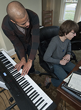 Theo Ndawillie II and Henry Lachman work together at the Triumph Music Academy