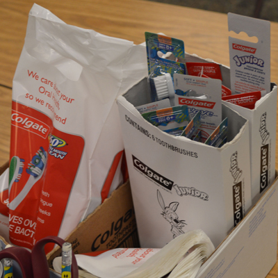 Baggies of toothbrushes, floss and toothpaste are sent home with students