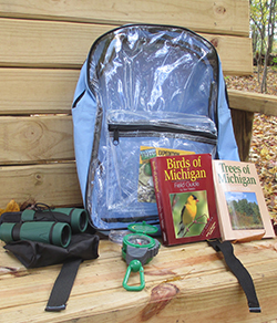 Backpacks contain compasses and other outdoor aids for students