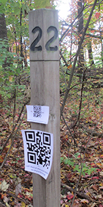 QR codes along the trail link to field guides and a trail map