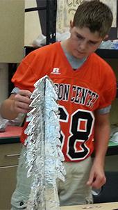 Student Dalton VanderArk creates a piece