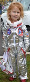 Veda Schuitema, 3, whose mother, Debbie Schuitema, is a Godfrey-Lee math coach, is a miniature astronaut