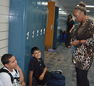 Lee Middle/High School Principal Kathryn Curry stops to chat with Lee High School students Luis Martinez and Leonardo Sanchez