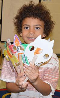 First-grade student Grayden Sharper stays busy with art