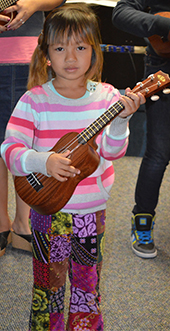 Newcomer Program student Paw Hyser Gay plays the ukulele