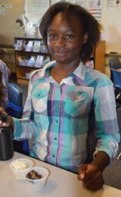 Southeast Elementary fifth-grade student Marquaisha Welch gets ready to eat her cake