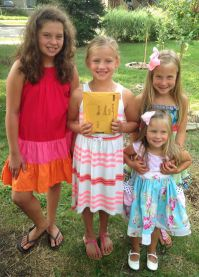 From left, Alexa Deising, Reese Hurley, Aubrey Grutter and Brynna Grutter have their envelope filled with money raised ready to deliver