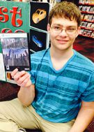 Rockford senior Kevin Stephan shows off the case his team designed for their shooter game,
