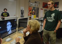 Julie VanderLaan watches student Ben Gammon's final film project
