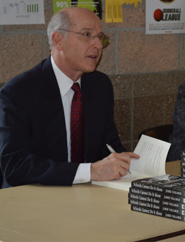 Jamie Vollmer signing copies of his book