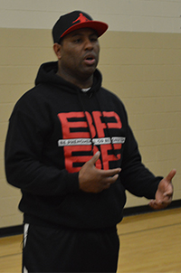 "Motivational speaker Eric Thomas challenges Crossroads Alternative High School students to turn ""street smarts"" into school success"