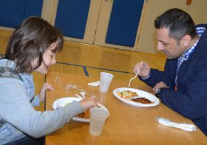 Sanel Aganovic eats breakfast with his son, Omar.