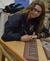 East Grand Rapids High School senior Alicia Dills works in Advanced Art class