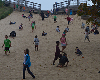 Wyoming students play on Tunnel Park sand dunes, an example of experiential learning