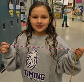 Second grader Olivia Potter shows off a red, white and blue section