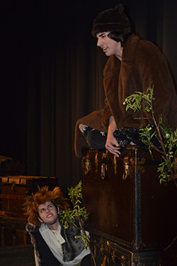 "Junior Christian Ochoa sits atop a trunk during a one-act play for ""Trunks 2"". Junior Heidi Glynn listens to his monologue"