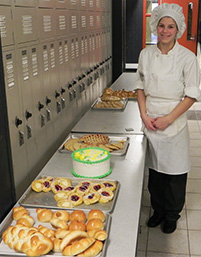 Hanna Kaiserlian shows off the baked goods she made for her submission to the competition