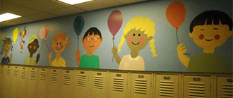 A mural at Hamilton Early Childhood Center smiles at students thanks to NAHS members