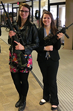 Karlee Karpowicz (left) and Madison Stan got to handle heavy firepower at the Leadership Conference
