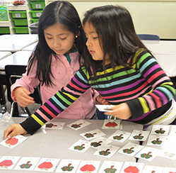 First-grade students Amanda Lopez-Rodriguez and Joselyn Rodriguez work on addition