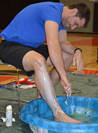 Teacher Jeff Dock agreed to shave his legs if students reached their donation goal