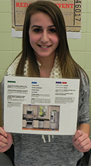 Courtney Pagniello holds up her guide for where foods go in the kitchen