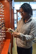 Sheliah Harris-Spencer checks out frames at Professional Eyecare of West Michigan