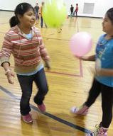 Migrant student Romalda Ordaz plays with a friend during gym class