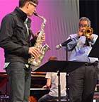 Faddis works on solos with Northview alto sax player Mason Biilo