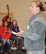 Air Force First Lt. Ashley Alexander speaks to the freshman women's chorus