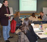 Michael Pyne, communications representative for Muskegon County Community Mental Health, trains educators on Mental Health First Aid