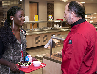 Chef Mo talks with student during breakfast