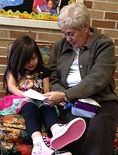 Grandma Barb Fellows-Krauss encourages Emely Bermudez-Hernandez to learn her words