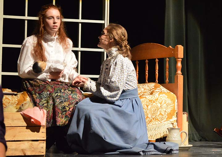 "Morgan Maggini (left) as Helen Keller and Hannah Moore as her teacher, Annie Sullivan, in a scene from ""The Miracle Worker"""