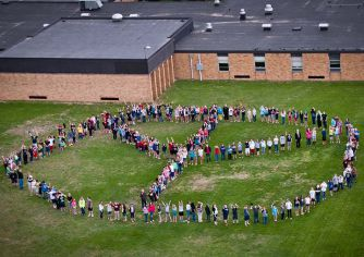 Cedar Springs Public Schools Red Hawk Elementary students create a peace sign for a recent helicopter flyover organized by the Mental Health Foundation of West Michigan. The foundation started the Be Nice initiative