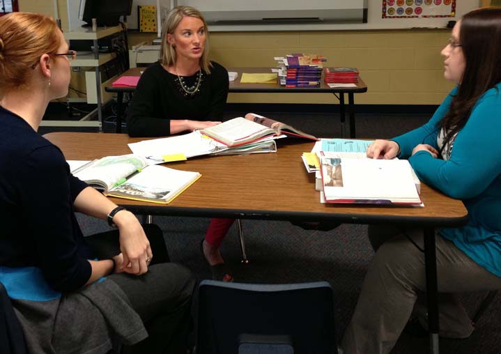 Southwood teacher Stephanie Poll (center) and interventionists Rebecca Wright and Jenna Engel discuss strategies to teach writing during their daily collaborative planning time